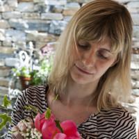 Elena Scalambrin preparing vases of fresh flowers at Relais del Maro,Borgomaro
